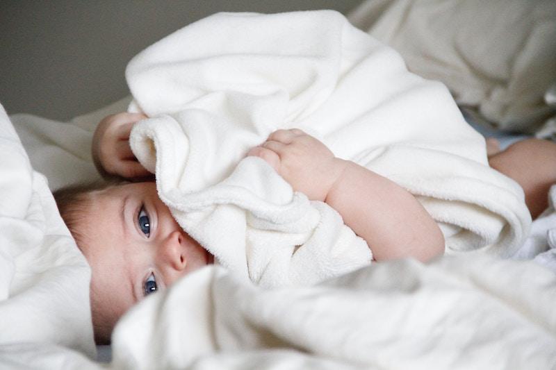 baby in laundry .jpg