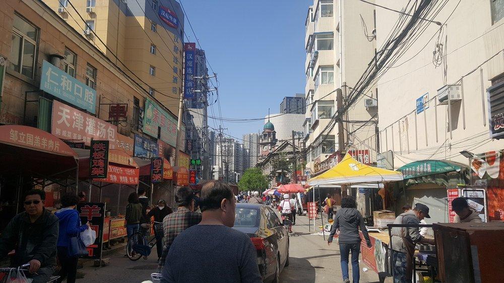 Ruby Carlson recording Shenyang street sounds, May 2017 photo credit: Sara Velas