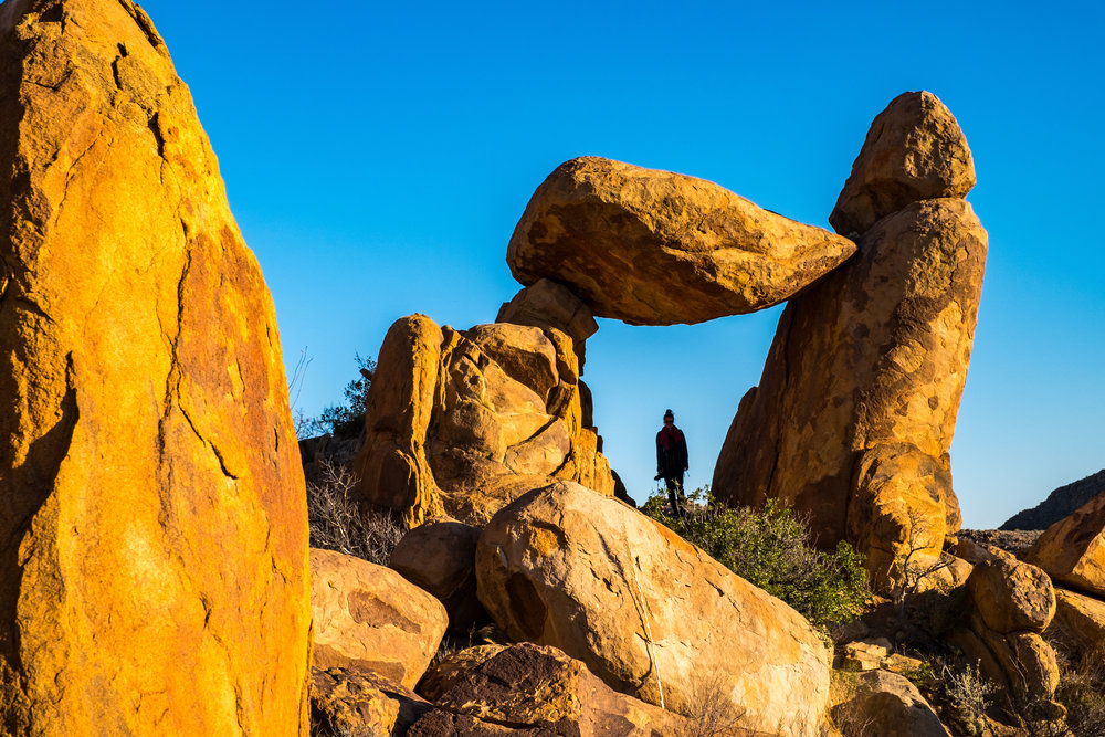 Under a balanced rock at Big Bend National Park in the great state of Texas!