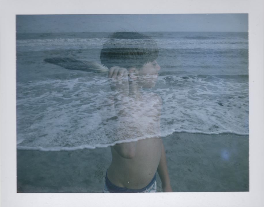 double-exposure portrait of child at the beach holding a feather // (c) jocelynmathewes.com