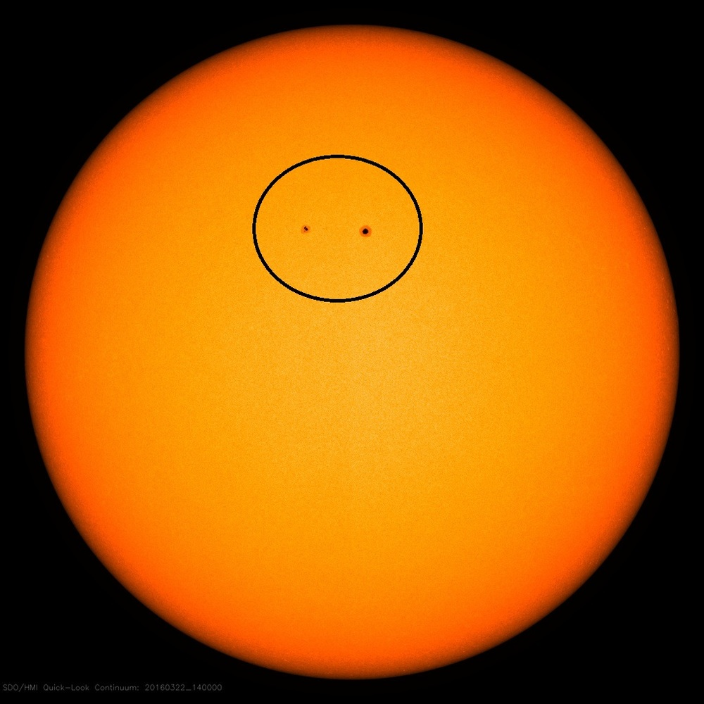 Current solar image with two visible sunspot regions: image courtesy NASA