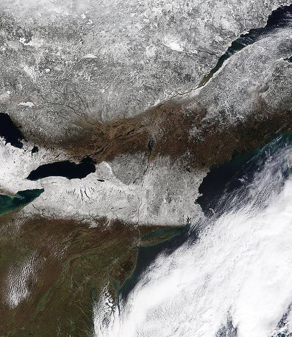 MODIS image clearly showing snow cover from the Great Lakes to New England; image courtesy NASA