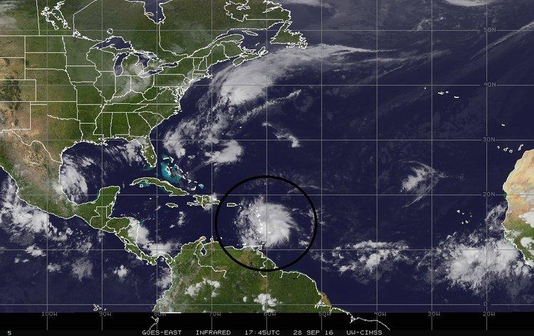 Latest satellite image of Tropical Storm Matthew (circled); image courtesy University of Wisconsin/SSEC, NOAA