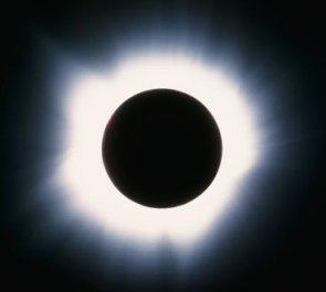 The Sun's tenuous outer atmosphere is called the corona and it becomes visible during a total solar eclipse. The corona is not normally visible since the Sun's disk is so bright that the relatively faint light from the wispy corona is overwhelmed.