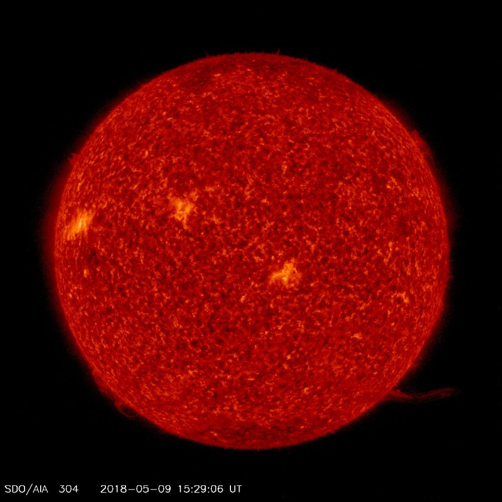 While the sun has been spotless more than half the time this year, there are currently three sunspot regions visible to Earth.This particular channel is especially good at showing areas where cooler dense plumes of plasma (filaments and prominences) are located above the visible surface of the sun. Many of these features either can't be seen or appear as dark lines in the other channels. The bright areas show places where the plasma has a high density. Image courtesy NASA/SDO