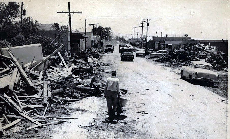 A man with a wheelbarrow starts to clean up one week after Hurricane Audrey. Courtesy Times-Picayune archive