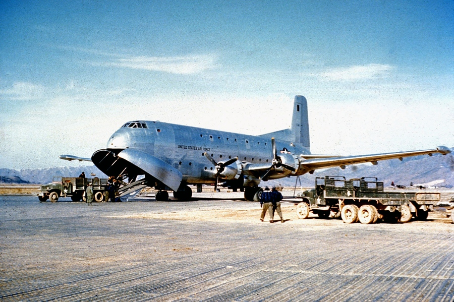 A C-124A Globemaster is unloaded on an airfield in Korea during the Korean War. (courtesy U.S. AIR FORCE)