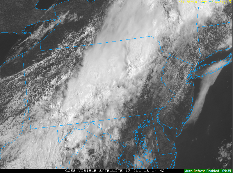 Mid-day visible satellite image which features clearing skies in the I-95 corridor ahead of the advancing strong cool frontal system; courtesy NOAA, College of DuPage