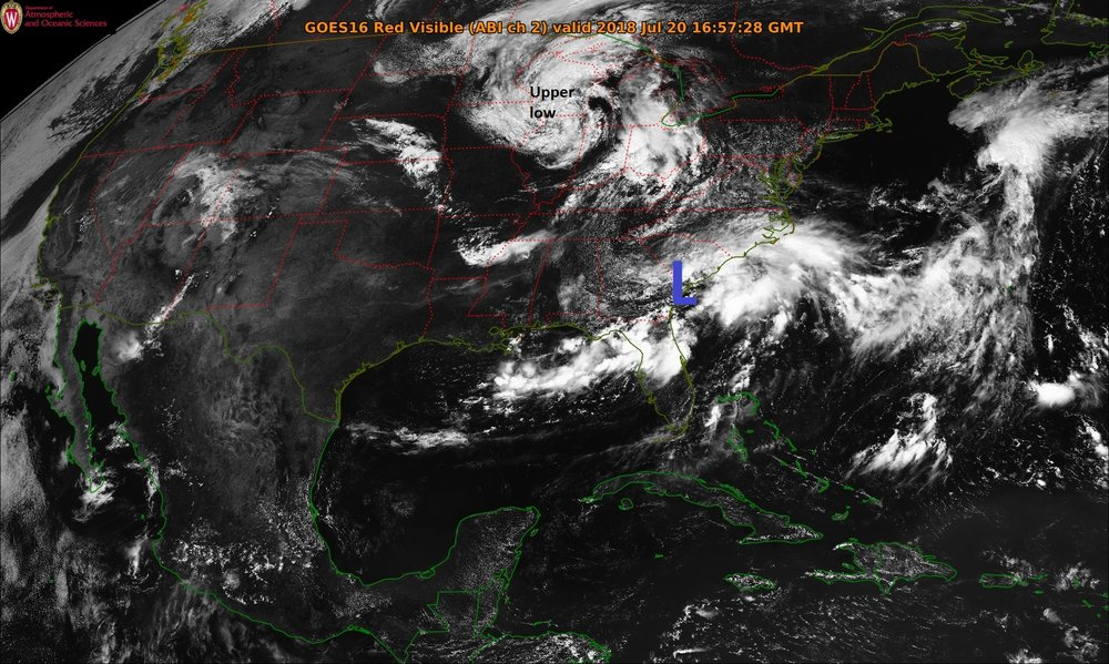Mid-day satellite image from NOAA's GOES-East features an upper-level low over the Upper Midwest and convection along the Southeast US coastline as surface low pressure forms.
