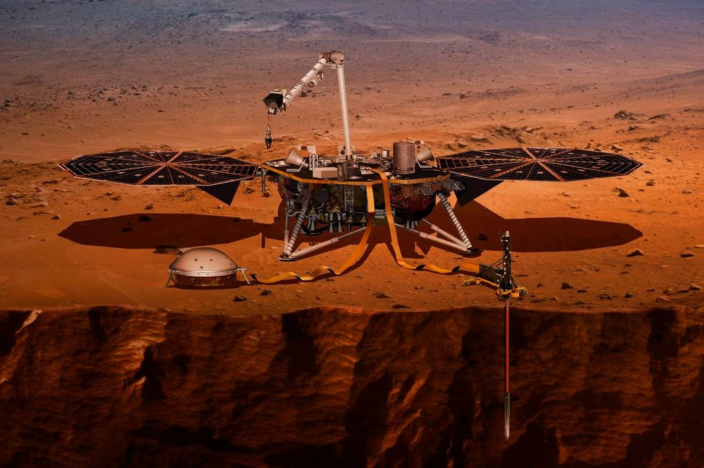 An illustration of NASA's InSight lander drilling into the surface of Mars. (NASA via AP)