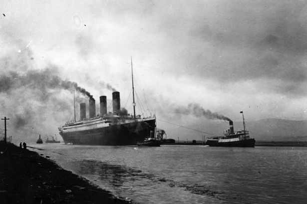 The SS Titanic being pulled by tugs as it is leaving Belfast shortly before her disastrous maiden voyage of April, 1912