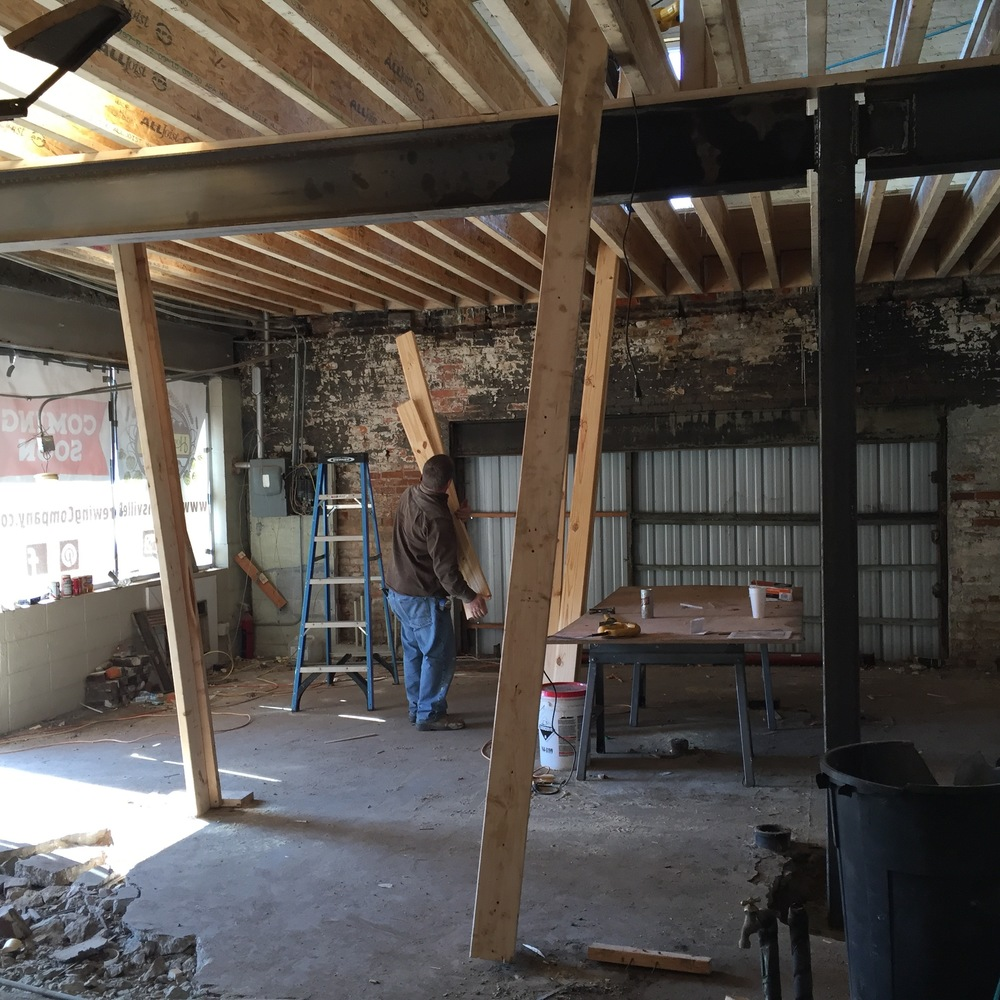With the steel beam in place, the floor joists can be put into place.