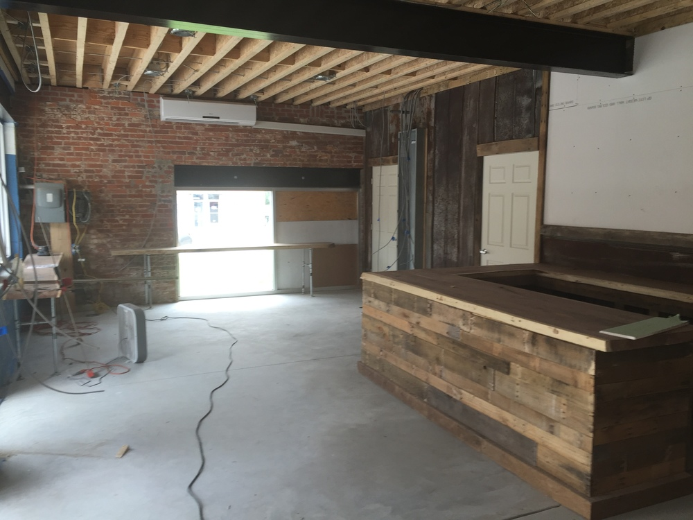 1/2 of our picture window is in place, overlooking Main St., with a long walnut bar in front.