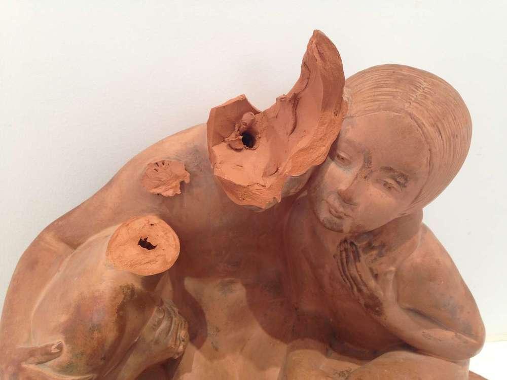 restauration statue terre cuite