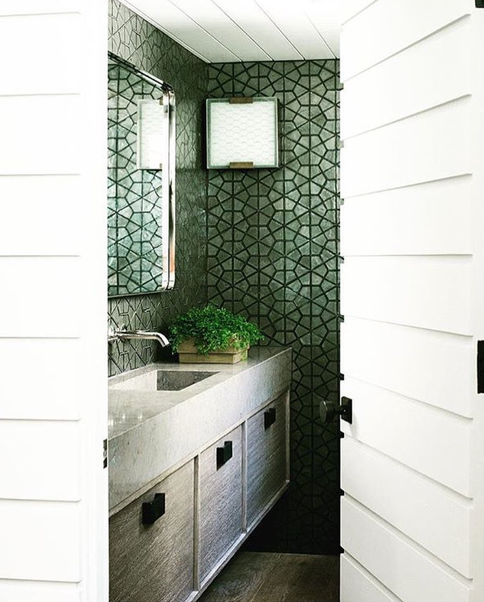 Emerald Green - Unexpected in a bathroom designed by Wendy Word Design. A floating vanity with a thickly skirted countertop (another big recent trend in bathrooms) and green mosaic tile. Lighting by Waterworks - love them!