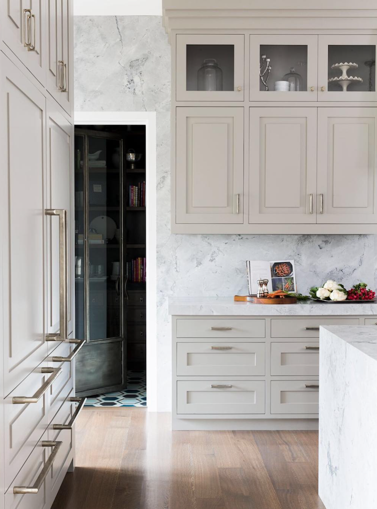 Off-White Cabinets - White is a great color - don't get me wrong - but let's change it up. Even a little off-white color can do the trick or combine two colors. We see more interesting materials and textures in kitchens and baths. Moving away from white is not quite as safe of course, and the coordination of materials takes skill and a good eye but the outcome is totally worth it.Design by Alice Lane