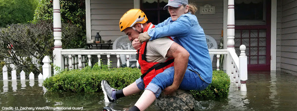From PDA: A Texas National Guardsman carries a resident from her flooded home following Hurricane Harvey in Houston.