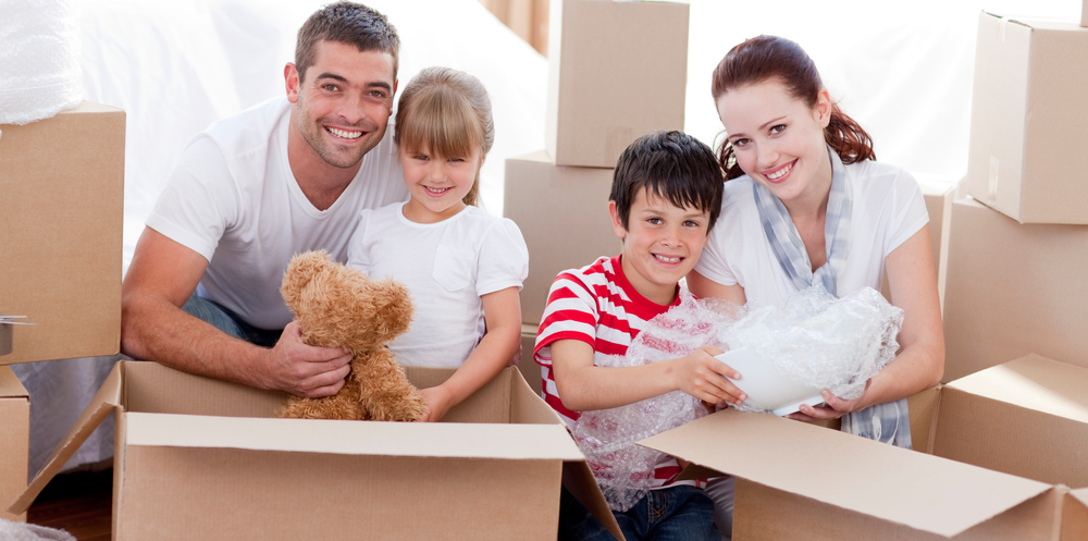 Family getting ready to move. Kings Transfer can help with your packing needs.