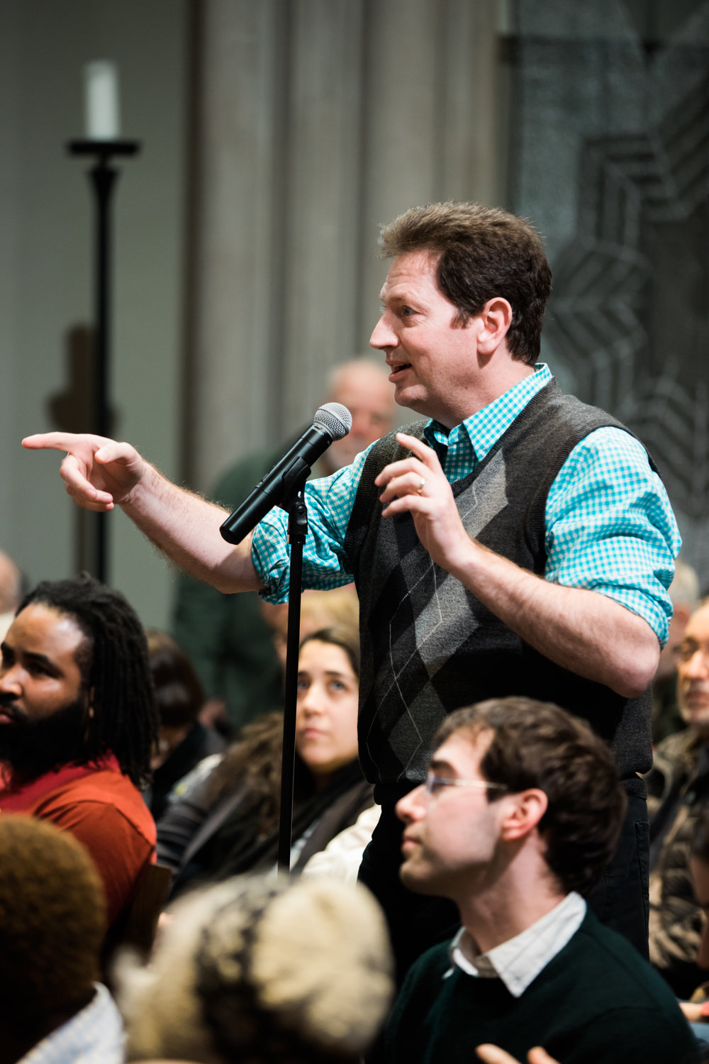 An enthusiastic audience member asks a question to panel members at Union Theological Seminary's Faith In America series. Photo by Daniel Lee.