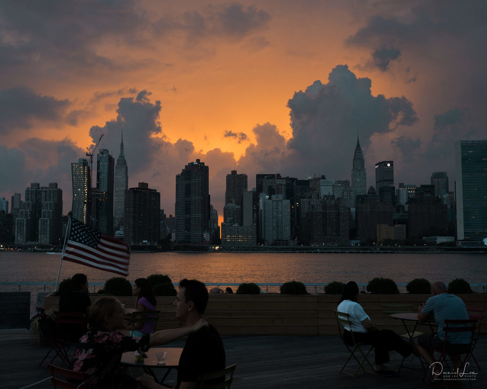 Residents and tourists alike enjoy a Manhattan sunset from Long Island City, Queens in the summer. Queens, NY. Photo by Daniel Lee.