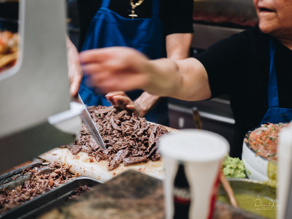Preparing carne asada for burritos at La Taqueria on Mission Street in San Francisco. Photo by Daniel Lee.