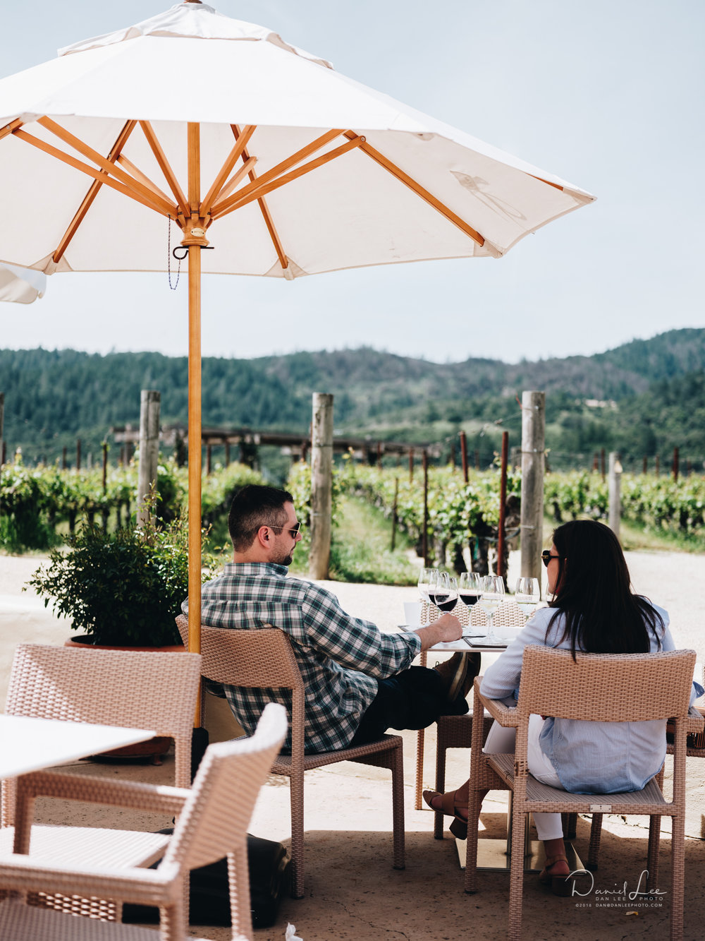 A couple enjoys wine tastings at Robert Mondavi Winery in Oakville, CA. Their Cabernet Sauvignon Reserve is extraordinary. Photo by Daniel Lee.