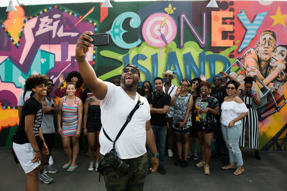 Gerold, one of the founders of the SLAPcollective, takes a selfie with members during a photowalk in Coney Island, Brooklyn.