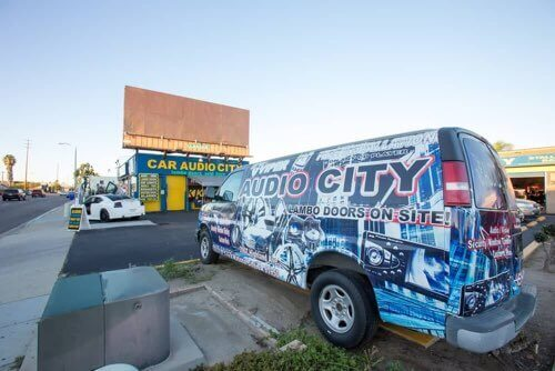 Check Out Our Wrapped Van in Front of Our Shop