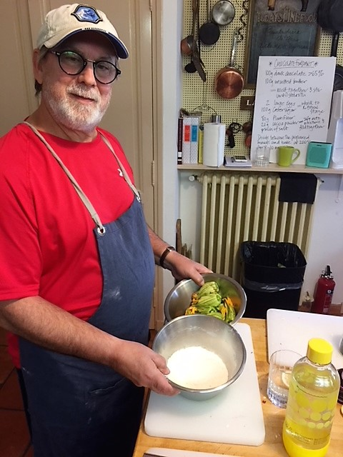Tom making squash blossoms with tempura batter.