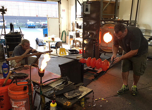 Mark Andrew and Guido Gerlitz of Effetto Glassworks blowing the Take Five.