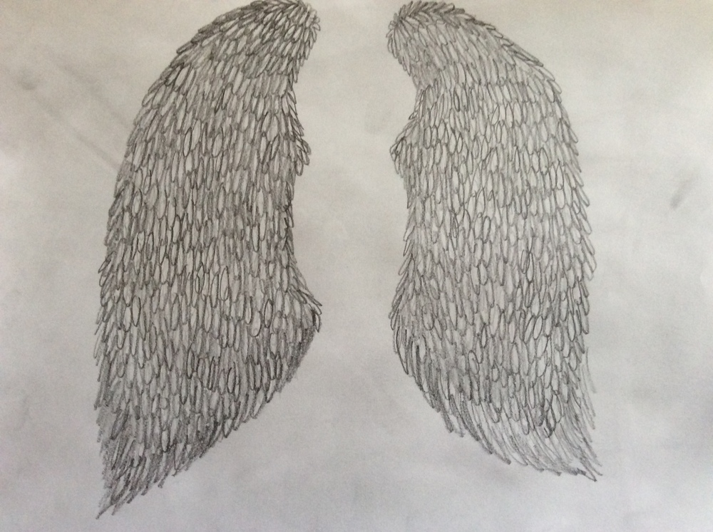 Lilly's sketch of angel wings by Abby Wilkins