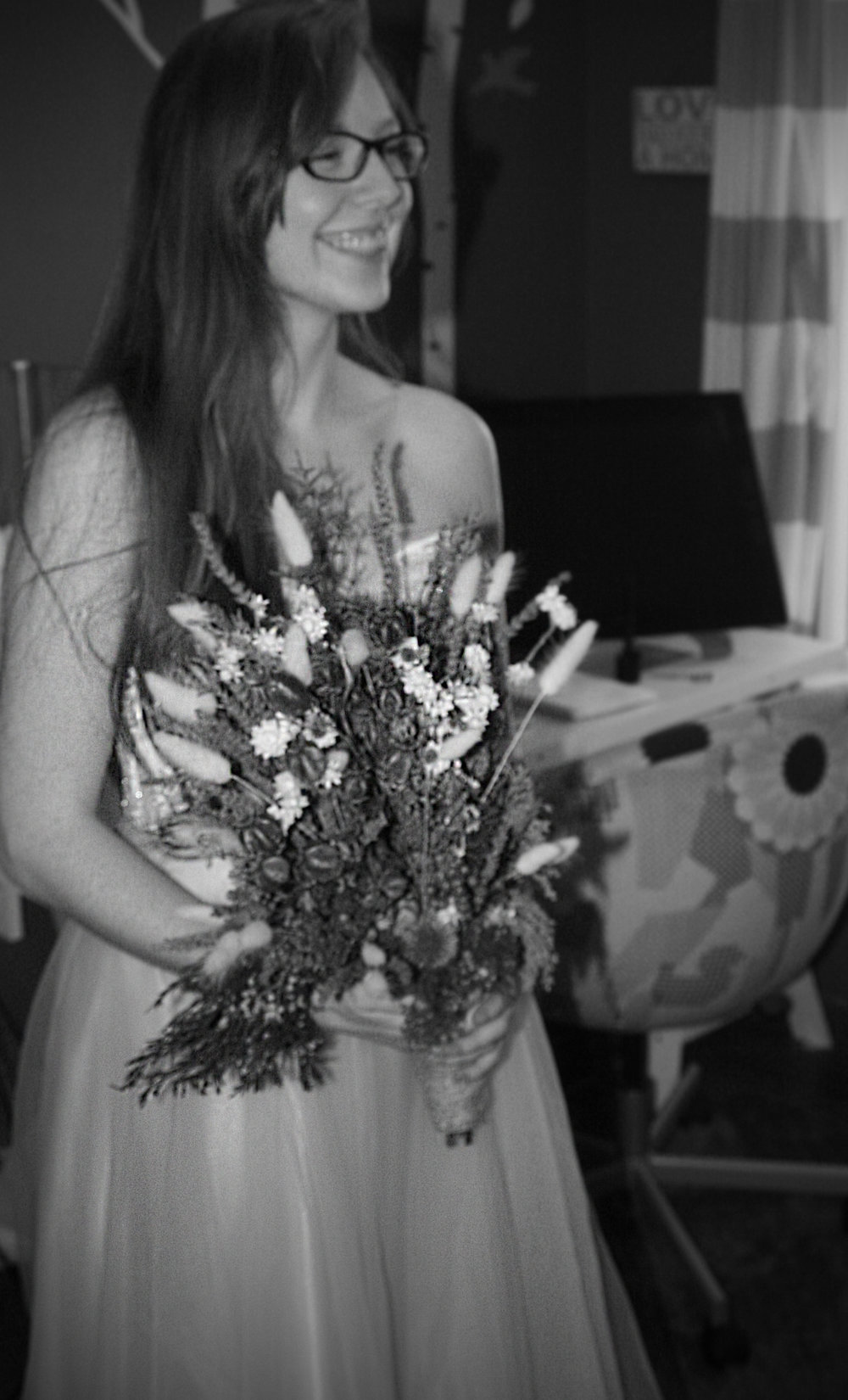 Last image of Kassandra posing with her new dress fitting correctly and testing out her bouquet (she created).
