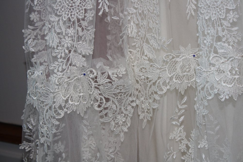 Close-up of the lace over the gathered seam.