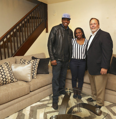 "Aaron's delivered an entire home makeover of new furniture, appliances and electronics to (L to R) Anthony Harper and Jasmine Dobbs pictured with Aaron's Director of Franchise Operations Ray Muncy. The Dobbs family of Granville, West Virginia, was recently surprised as the grand prize winner of the ""Big Blue Bow Home Makeover"" on ""The Wendy Williams Show."""