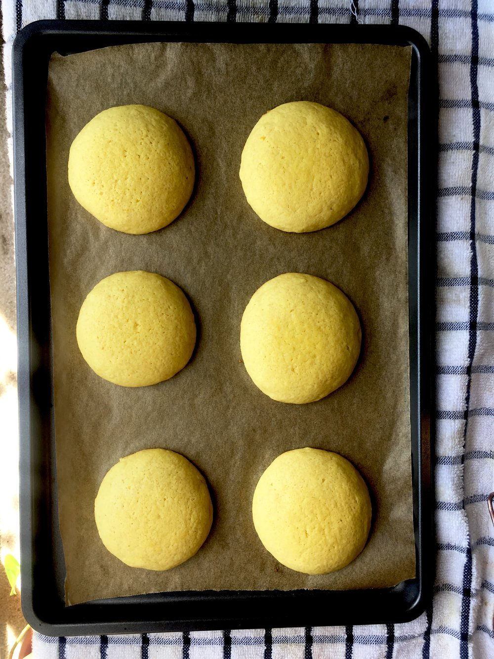 Bake for 12 minutes. Take out and let cool on baking sheet for 4 minutes.