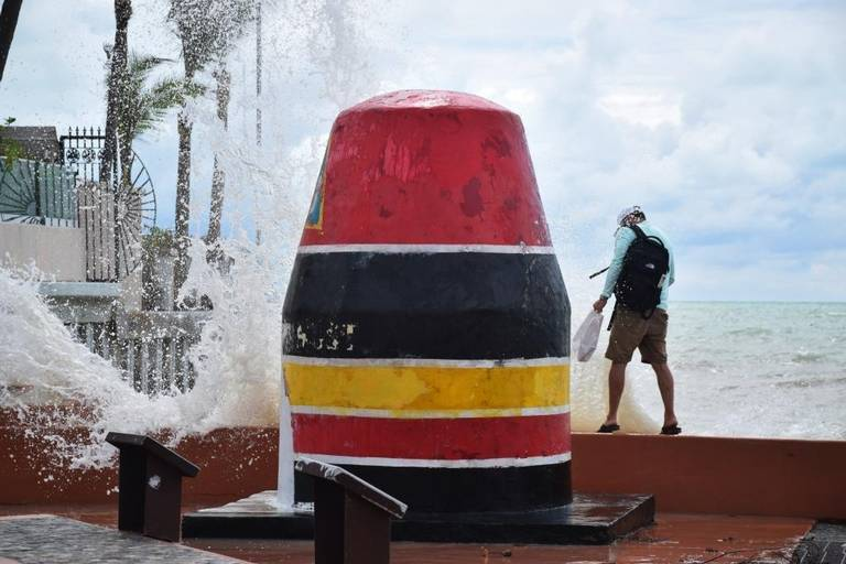 Tourist at the Southernmost Point Buoy in Key West on Oct. 5, 2017. Photo by Chabeli Herrera.