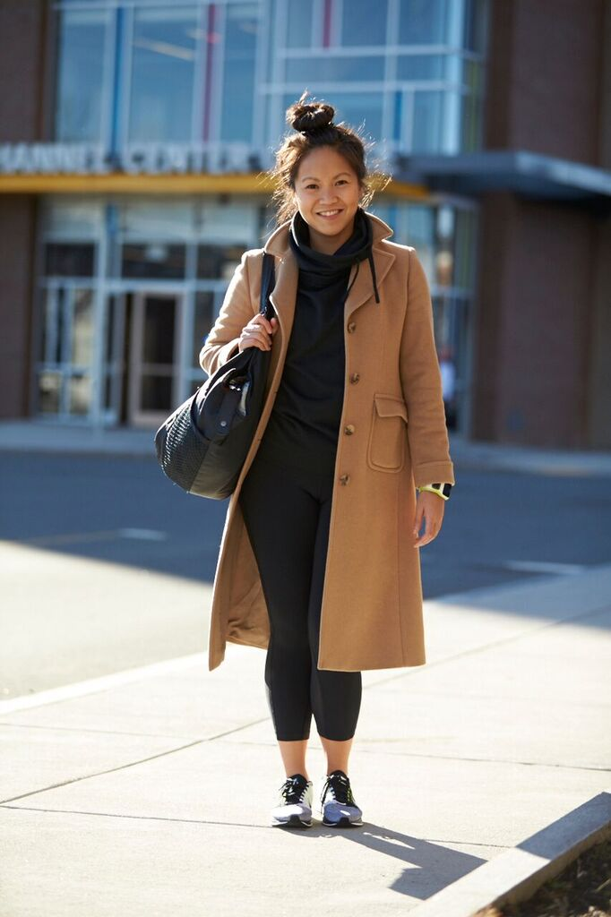 Coat: Brooks Brothers, Top: Nike, Crops: Nike, Sneakers: Nike, Tote bag: Nike, Watch: Tom Tom Photo by Josh Campbell
