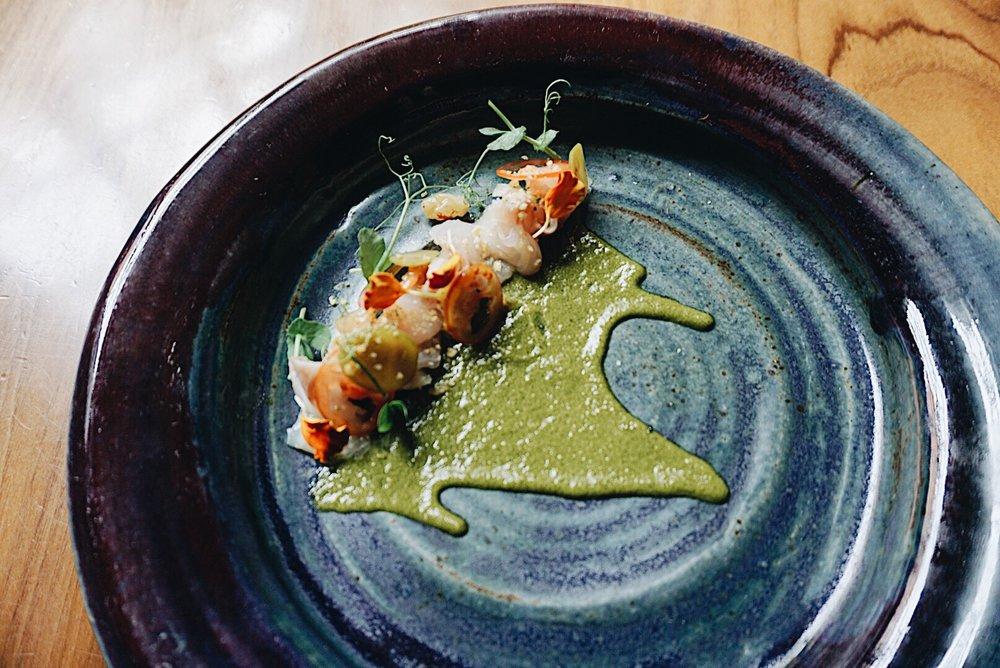 Lubina (Spanish Sea Bass) Sashimi; green chermoula, sultanas, preserved lemon gremolata