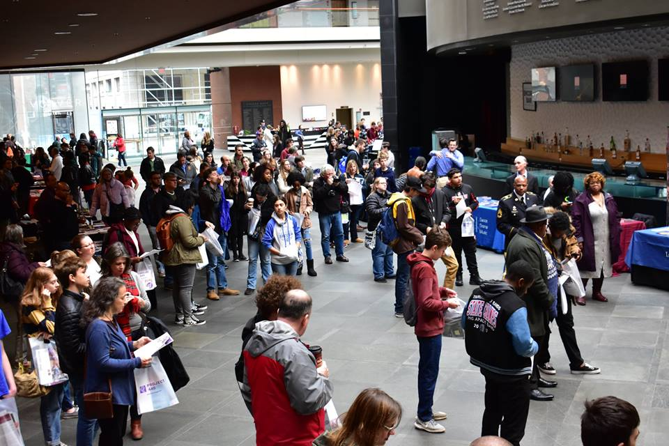 College Fair attendees listening to announcements from the stage. Photo Credit: Chloe Cooper