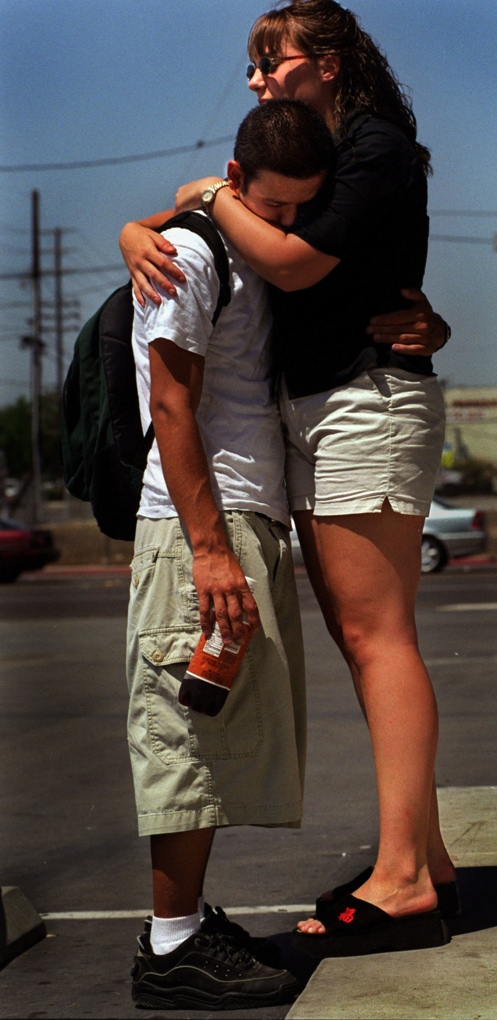After being kicked out of his apartment during day time hours to look for a job, Jesse hangs out with girlfriend, Rebecca, at the end of his street. He was given a two week warning to find a job or lose his transitional housing. ©Gail Fisher Los Angeles Times