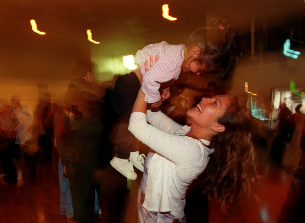 "During the graduation festivities at Mariner's church, Monique Luna and daughter Lyla Molina, take a few spins on the dance floor. ""I had never been to a prom. That was like my prom. I had my little girl. So it was more than just a graduation. She's my whole family. Everybody that needed to be there was there,"" says Monique. ©Gail Fisher Los Angeles Times"