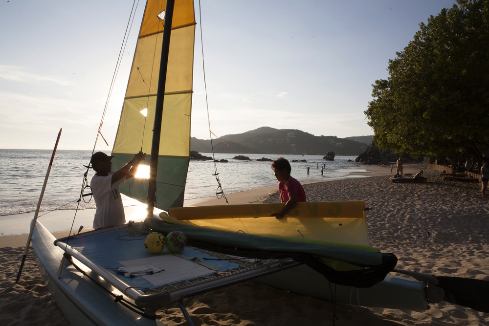 At the end of the day, sails are taken down on Playa La Ropa, one of Zihua's most magnificent beaches, a short a 20-minute walk or a five-minute taxi ride from town. ©Gail Fisher