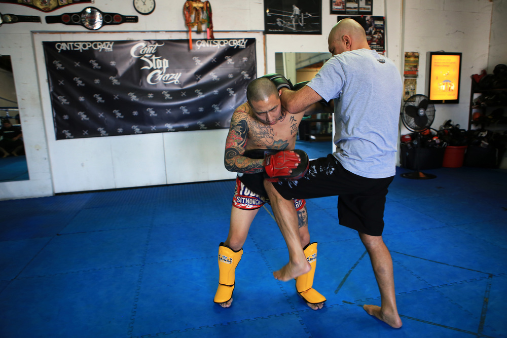 Gracie, right, Brazilian professional mixed martial artist, (MMA Founding Father), trains with Hisataka, left, using some of his Jiu-Jitsu moves for his upcoming fight against Ken Shamrock. Gracie defeated Shamrock, a fellow UFC Hall of Famer, by submission in just 57 seconds during their first fight at UFC 1. (©Gail Fisher for ESPN)