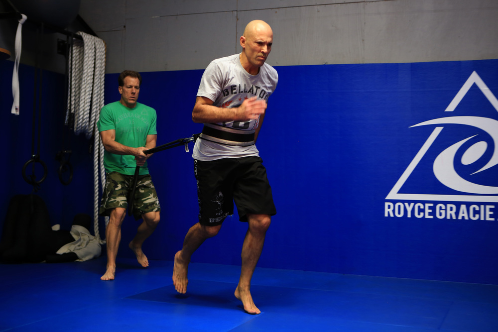 Gracie, right, UFC legend, trains with Strom, left, former strength and conditioning coach for the USC Trojans and LA Rams, during a strenuous workout at the Royce Gracie Jiu-Jitsu Academy in Torrance, California. (©Gail Fisher for ESPN)