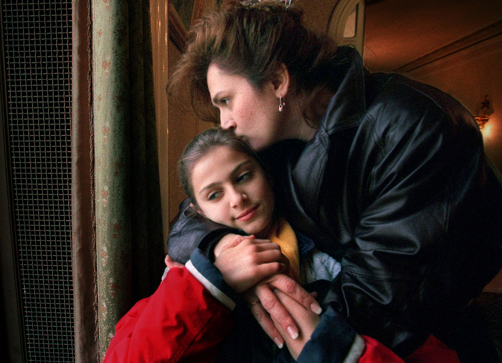 Left, Alexandra and her mother, Viorica Nechita, share a quiet moment together in London, part of their seven-nation European tour in March--in which Alexandra was feted by government officials and accorded the media coverage of a head of state. ©Gail Fisher Los Angeles Times