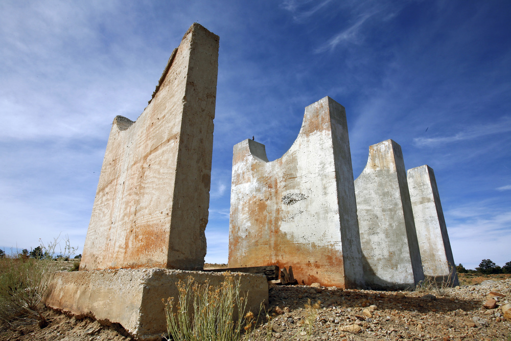 United Nuclear Corp. capped the mineshafts on the cliffs over-looking Red Water, (now known as Church Rock Mine) but left an array of concrete pillars and flat circles of blue metal that resemble an industrial Stonehenge. ©Gail Fisher Los Angeles Times
