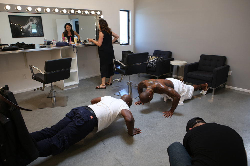 A few push-ups helps Miller warm up for the shoot. © Gail Fisher for ESPN