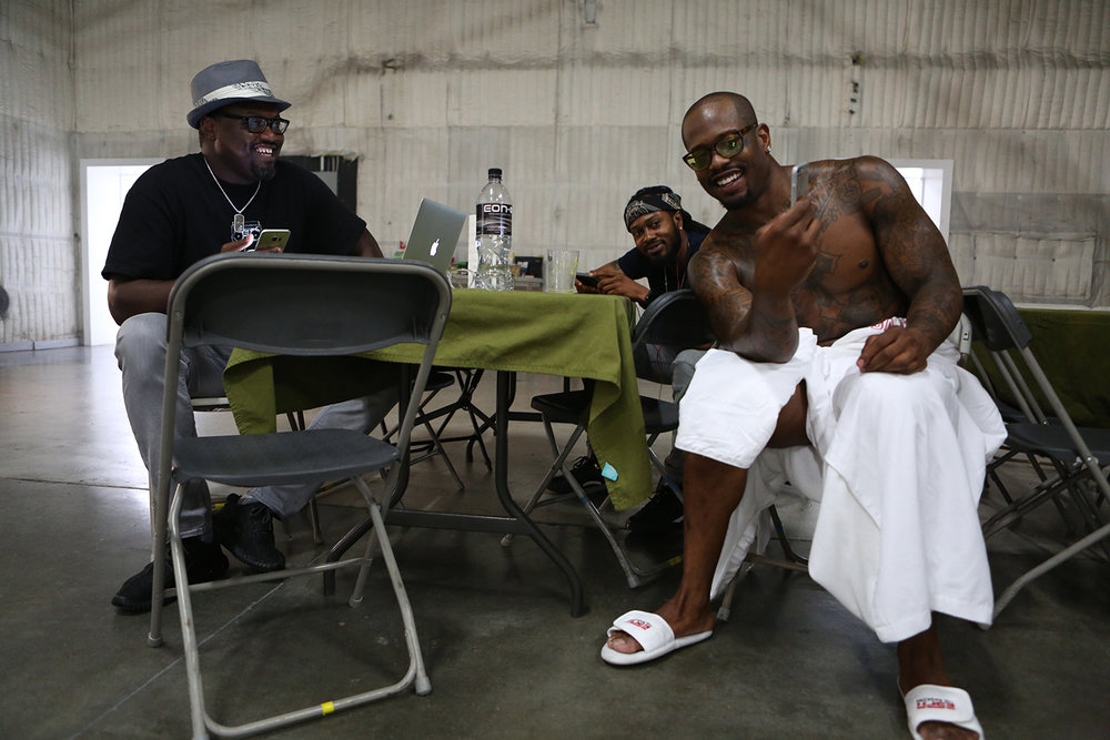 Miller hangs out with his agent, left, and his brother, center, during a short break. © Gail Fisher for ESPN