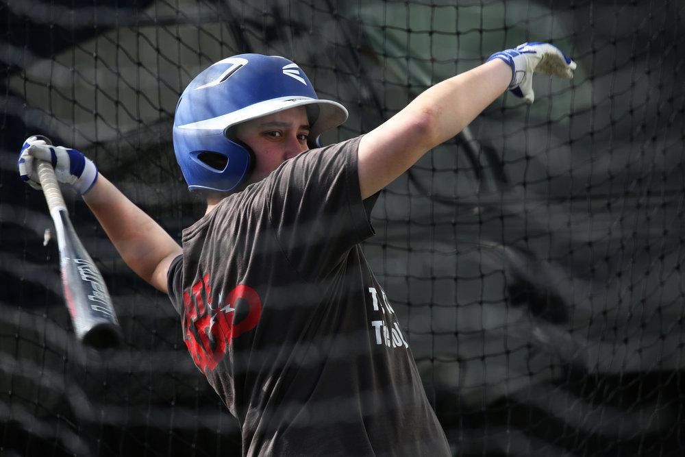 "Hofheimer takes his turn at the batting cage. ""I think it's important to show the sports world that not all trans people are bad athletes-that there are trans people who enjoy sports and are treated as their gender identity and not as anything else."" © Gail Fisher for ESPN"