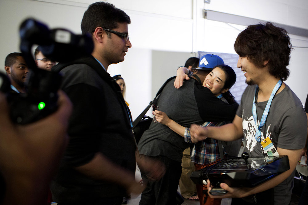 EVO is an esport event to mingle with the best of the best. Diego Umehara is congratulated by a fan. © Gail Fisher for ESPN